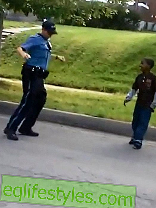 Good cop: Policeman is dancing with children on the street