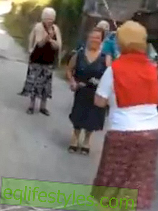 Senior couple on the street: grandmas jumping rope