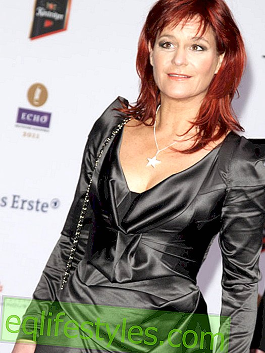 Andrea Berg prays at the bedside for her parents
