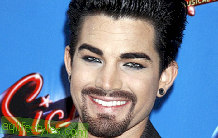 Adam Lambert is snogging around with a woman