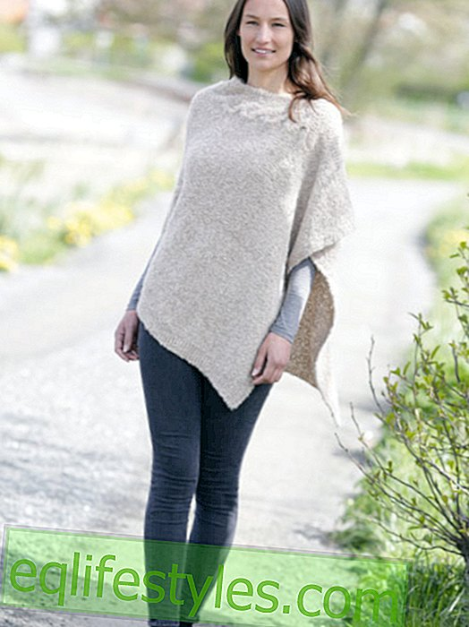 Poncho with ruffled ribs and cable pattern