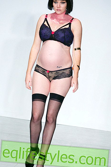 Models present lingerie with baby belly
