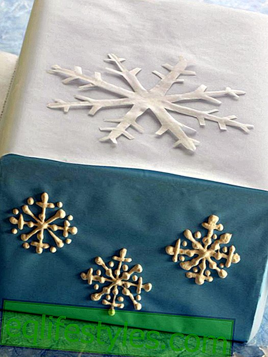 Blue gift wrap with painted snowflakes