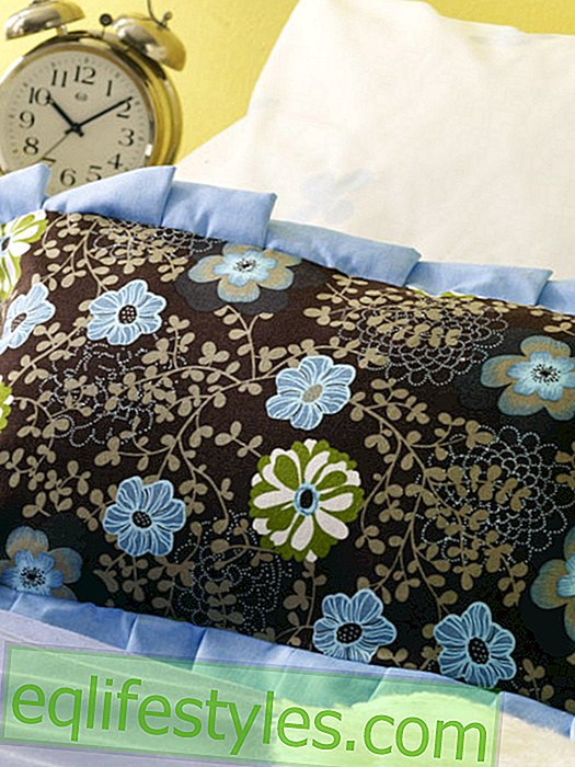 Floral pillow with ruffle