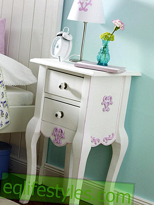 Bedside table with wooden ornaments