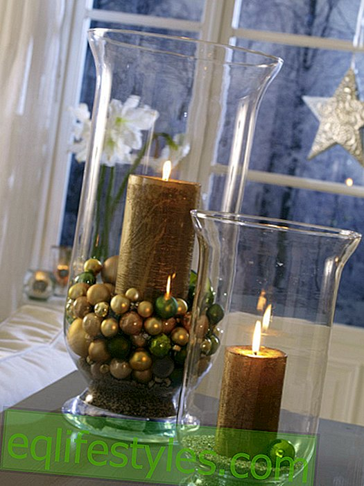 Large lanterns with candles in gold