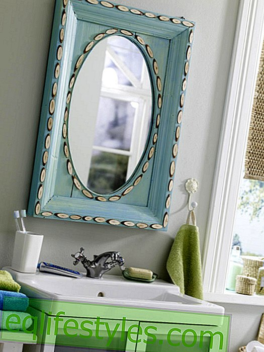 Bathroom mirror with wooden frame